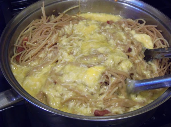 Add the egg and cheese mixture to the pan and mix quickly and well....