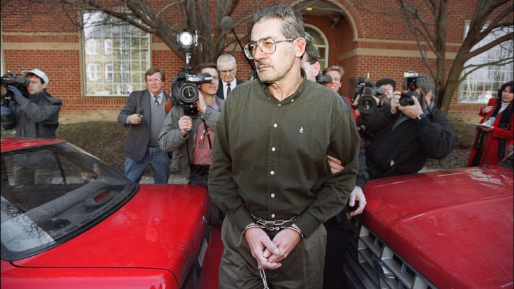 Aldrich Ames in handcuffs.  Photo: Luke Frazza/AFP/Getty Images
