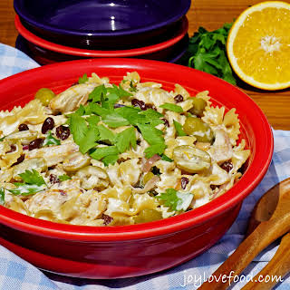 Creamy Chicken Pasta Salad with Green Olives and Raisins.