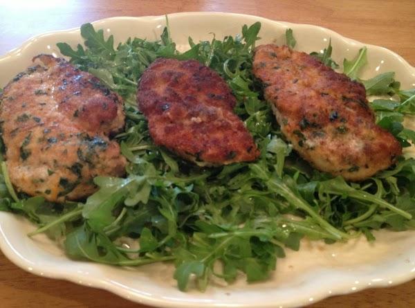 Arrange Arugula on platter.  Lightly dress with vinaigrette.  Place cutlets on top...