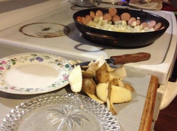 Peel and dice potatoes. Cut kielbasa into coins. and crush garlic, don't cut put...