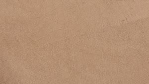 béton marron enduit décoratif à poser soi-même avec taloche en inoxe pour réaliser un sol en béton ciré couleur marron clair