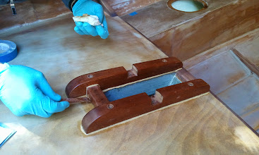 Photo: Cleaning up the squeezed out epoxy on the main mast partners.
