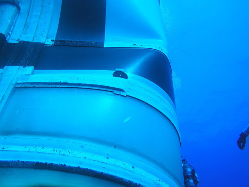 A dent was discovered by divers preparing to recover the spent stage following the launch of the flight test mission.