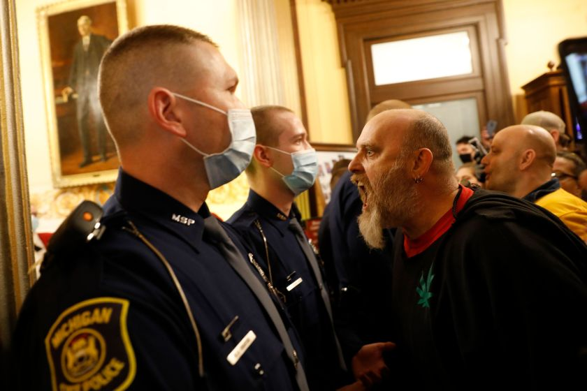Protesters try to enter the Michigan House of Representatives chambers