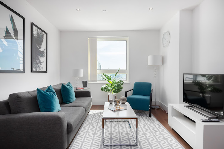 Bright living room at Lincoln Plaza Serviced Apartments, Canary Wharf, London