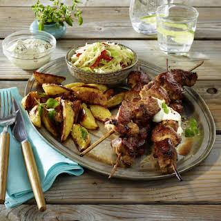 Pork Souvlaki with Potato Wedges and Coleslaw.
