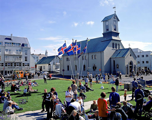 Austurvöllur Square in Reykjavik, Iceland, is a popular meeting place for locals and tourists.