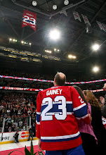 Photo: MONTREAL - FEBRUARY 23: Bob Gainey of the Montreal Canadiens watches a banner with his number 23 be raised to the rafters during his jersey retirement ceremony prior to a game against the Columbus Blue Jackets at the Bell Centre on February 23, 2008 in Montreal, Quebec, Canada.  (Photo by Andre Ringuette/NHLI via Getty Images) *** Local Caption *** Bob Gainey