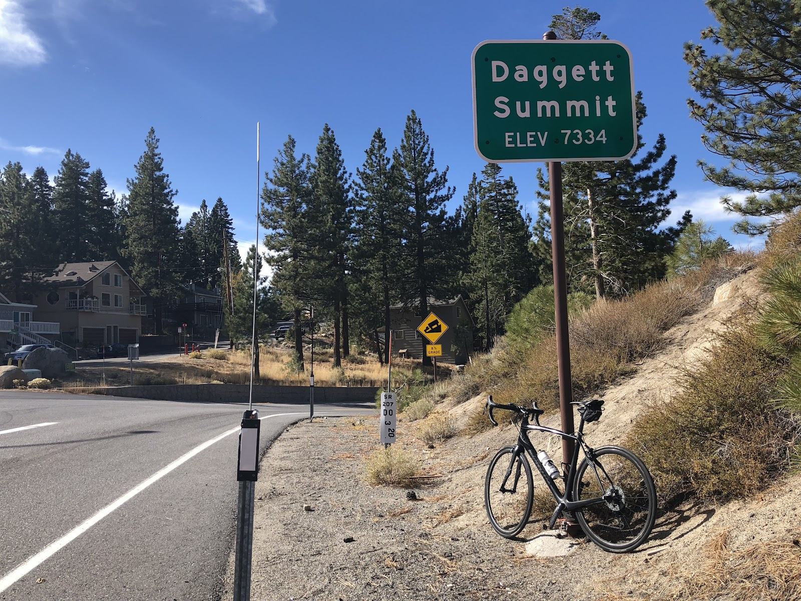 Cycling the Kingsbury Grade - Daggett Pass; pass sign with bike leaning against it.