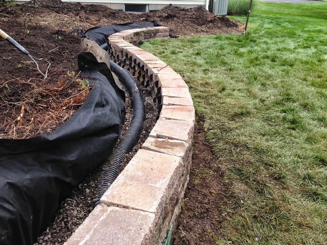 Photo: Retaining Walls Construction & Repair Sevices in Rochester, Monroe County NY  Retaining Walls Construction & Repair Sevices in Rochester, Monroe County NY by Acorn Ponds & Waterfalls.   Check out our website www.acornponds.com and give us a call 585.442.6373.  Do you know someone who has a retaining wall that is falling down? We can help. Call now or view more of or work and fill out a Contact Form on out website to schedule a design consultation here: http://www.acornponds.com/contact-us.html  Visit our website info on Retaining Wall Repair & Construction here: http://www.acornponds.com/retaining-walls.html - in Rochester NY  Learn more about Retaining Wall Repair, Renovation & Construction in the Pittsford, Brighton, Fairport, Penfield, Irondequoit and more in The Greater Rochester New York (NY) Area: https://www.facebook.com/notes/acorn-ponds-waterfalls/retaining-walls-repairsbrick-wall-installation-renovation-rochester-monroe-count/755282901175501  Find us on Houzz here: www.houzz.com/pro/acornlandscapedesign/acorn-landscaping-and-ponds-llc  Click here for a free Magazine all about Ponds and Water Features: http://flip.it/gsrNN   Sign up for your personal  design consultation here: www.acornponds.com/contact-us.html   Acorn Ponds & Waterfalls   585.442.6373 www.acornponds.com