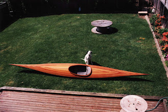 Photo: Checkers and the cedar strip kayak. Built in our basement in North Vancouver.