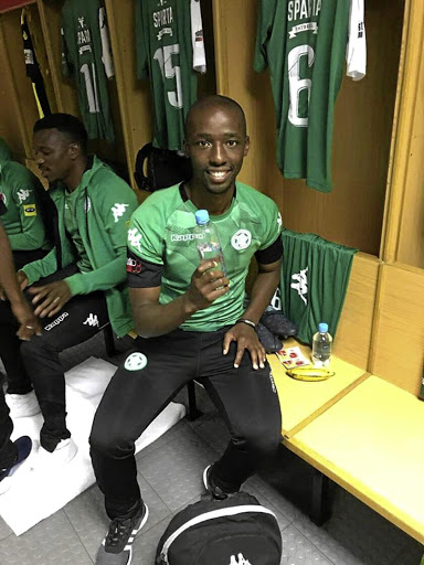 Mpho Maruping, now with Free State Stars, shows off his own brand of bottled water.