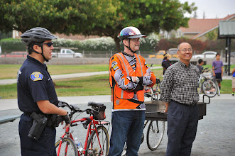 Photo: Officer R. Lopez, Art Ebright (from the Veterans Commission, and Mayor Jose Esteves.