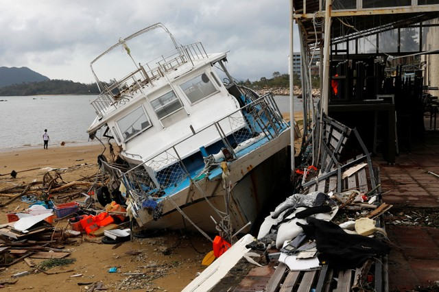 A vessel is seen being moved onto the beach after Super Typhoon Mangkhut hit Hong Kong, China September 18, 2018