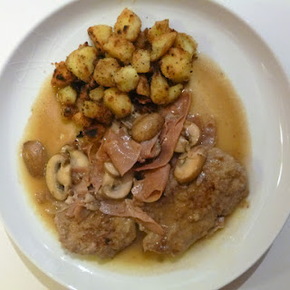 Veal Escalope's, Prosciutto and Mushrooms in a Vermouth Sauce with Sautéed Potatoes