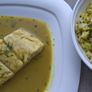 Snapper in Coconut Curry Sauce with Tropical Fried Rice.