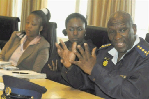 IN CHARGE: Police Commissioner General Bheki Cele and his spokesperson Nomkululeko Mbatha during a meeting with Avusa editors in Rosebank yesterday. Pic: PETER MOGAKI. 21/04/2010. © Sowetan.