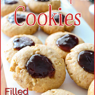 Almond Thumbprint Cookies Filled With Triple Berry Jam.