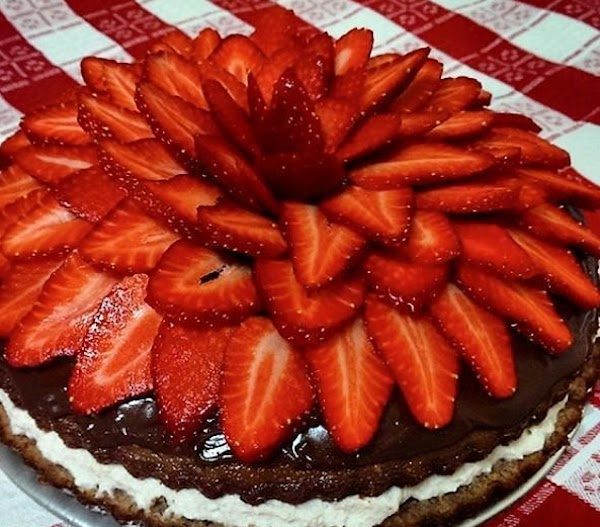 STRAWBERRIES LAYER;  Top the CHOCOLATE PUDDING or (the Optional Nutella) 2nd. Layer, with Sliced...