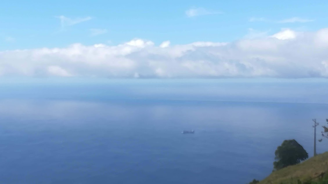 View from our garden: a band of clouds bends around the western tip of Madeira