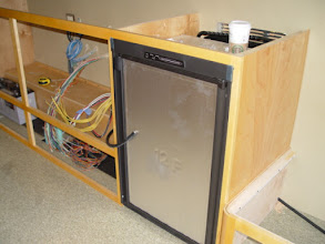 Photo: cabinets and refrigerator installed