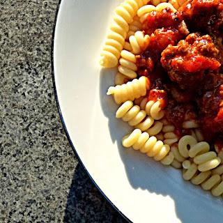 Fusilli With Meatballs In Tomato Sauce.
