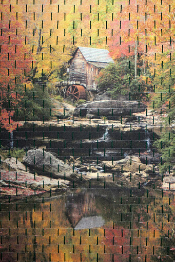 """Photo: Close up of """"focal point""""—gristmill and reflection of gristmill in the water."""