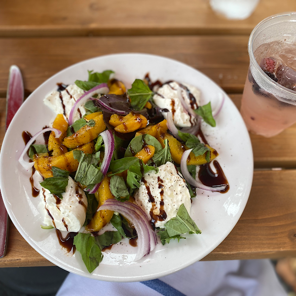 Peach and burrata salad with balsamic reduction.  Absolutely delicious.