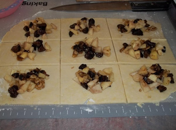 Add a generous tablespoon of the apple mixture to the center of each square....