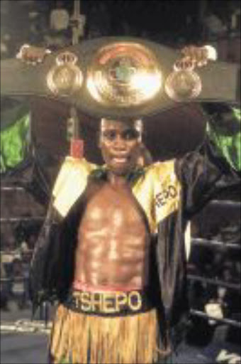 TANZANIAN IS NO MATCH: Junior middleweight champion Tshepo Mashego will fight Karama Nyilawila over 10 rounds at Nasrec Arena on August 10. Pic: Watson Mcoteli. 07.08.2004. © Sowetan    SW20040807WMC006:SPORT:BOXING:07AUG2004 - Tshepo Mashego fought with Farai Kachigwanda from Zimbwabwe at Witbank for WBA Pan African middleweight title, Anthony won on points. PHOTO:WATSON MCOTELI