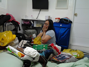 Photo: Mitch overwhelmed with all the things she needs to pack! Pasalubong for friends back in the Philippines.