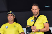SA senior men's national cricket team captain Faf du Plessis (R) looks on during the rain delayed start of the 4th ODI between Sri Lanka and the Proteas at Pallekele International Cricket Stadium on August 08, 2018 in Pallekele, Sri Lanka.