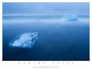 Photo: Shooting in Iceland  #PhotographyTips  Here's the link to our Day 4 Trip Report for our Iceland Trip. Shares are always enormously appreciated!  http://www.photographybyvarina.com/photography/blog/iceland-day-4-2  And here's another shot from my iceberg series. For this one, I wanted to capture the shifting motion of the bergs as they were rocked by the waves. In order to show that movement, I needed a long exposure. This one is 30 seconds. As most of you know - I often strive for minimalism in my compositions. This shot is no exception. I wanted an extremely simple canvas - so the long shutter speed served to smooth the surface of the water and simplify the background. And finally, I made sure to keep my blues as clean as possible in post processing... I didn't want any distracting color casts sneaking in there.  Is this what the scene looked like in reality? Of course not! Waves were crashing at my feet, I could see textures in the sand and the water, the ghosting effect is caused by the long exposure, and the blues were not so intense on location. But... this is exactly what I saw in my head while I was standing there shooting. This isn't documentary photography... it's art. A little bit of the dream world that exists in my head. I hope you enjoy it!