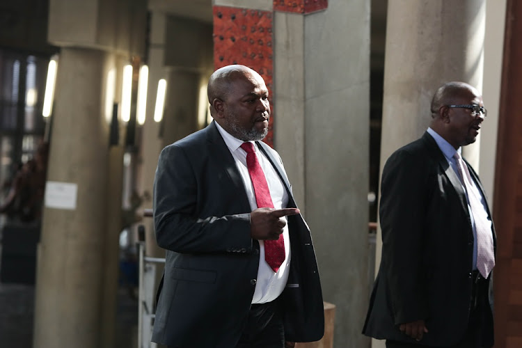 Former NPA head Mxolisi Nxasana enters the Constitutional Court in Johannesburg on August 13 2018, where the court ruled that the appointment of Shaun Abrahams as NPA head was unconstitutional and invalid.