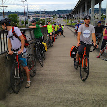 Photo: What to do while waiting for a barge to pass? Look around, stretch, or plan how to stay ahead of the group when the draw bridge re-opens. It's a full-on sprint everytime.