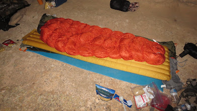 Photo: Sleeping in a cave while scouting for sheep.  Love the Montbell bag and Xped air mattress