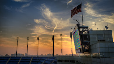 Photo: Sunrise at the Open  Last week I had a gig out at Arthur Ashe Stadium in Flushing for the US Open setting up for the opening ceremonies and our call time on day 1 of set up was 5am! Only perk to being up that early was the beautiful sunrise we were treated to while on the roof of the stadium setting up. I sneaked away for a few minutes to grab this 3 shot HDR with the X100 (which I carry with me everyday now!).
