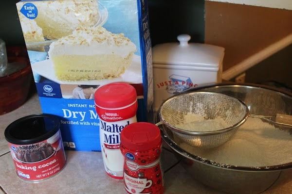 Sift the powdered sugar into a large bowl.