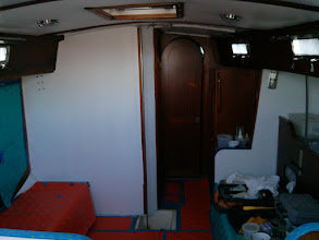 Photo: looking forward from galley after painting both salon bulkheads