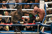 Deontay Wilder  lands a left hand against Tyson Fury, who will take on Otto Wallin this weekend. / Philip Pacheco/ Getty Images / Anadolu Agency
