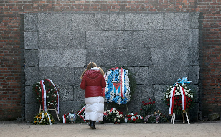 "Wreaths and flowers are seen after a wreath-laying ceremony at the ""death wall"" at the former Nazi German concentration and extermination camp Auschwitz, during the ceremonies marking the 75th anniversary of the liberation of the camp and International Holocaust Victims Remembrance Day, in Oswiecim, Poland, January 27, 2020."