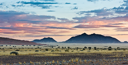 Photo: Here's a #SunsetSaturday photo (well OK, it's a sunrise...) taken just inside the Sossusvlei Desert Reserve in Namibia. I was supposed to be trying to beat the rush to get to the dunes and vlei. It felt a bit criminal to keep driving with this happening out the car window however so I pulled over and took a few photos before the light was gone.  Apologies for the panoramic crop +Diana Varbanescu and +Sumit Sen!