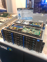 Photo: The current iteration of Tyan's hosting center in a box.  4u, 16 independent nodes, including a network.