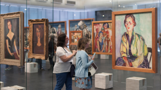 image of two women looking at art