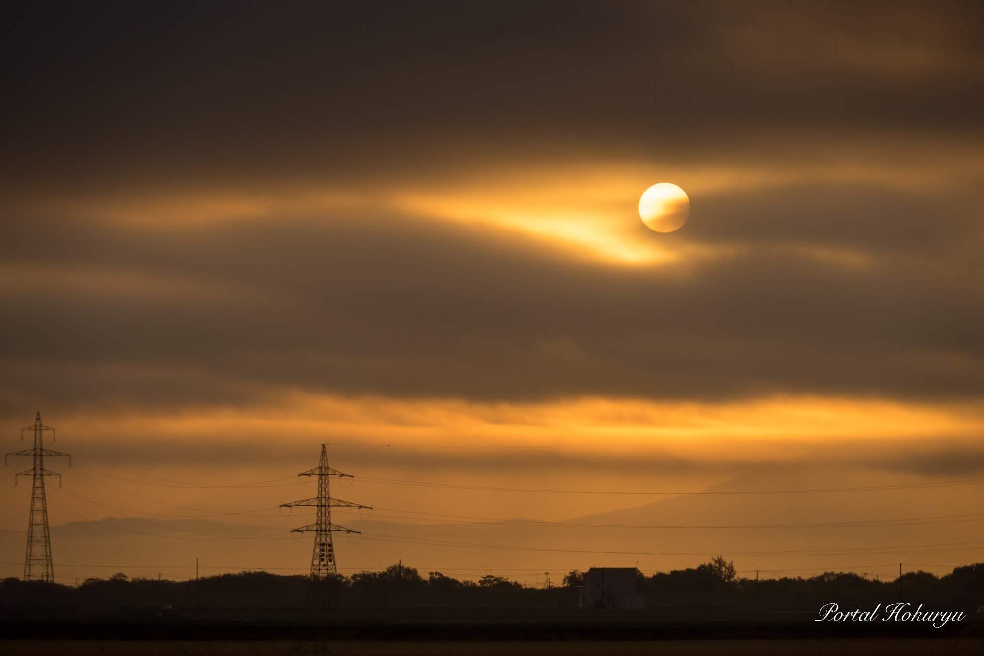 満月のような夕陽