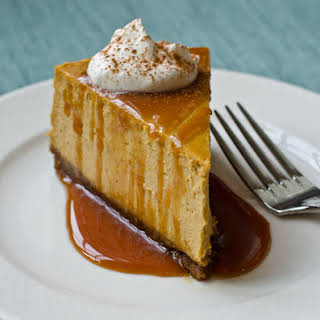Pumpkin Cheesecake with Gingersnap Crust and Caramel Sauce.