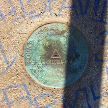 Photo: L.A. County Survey marker on Glendora Peak (2596'). The date reads 1937.