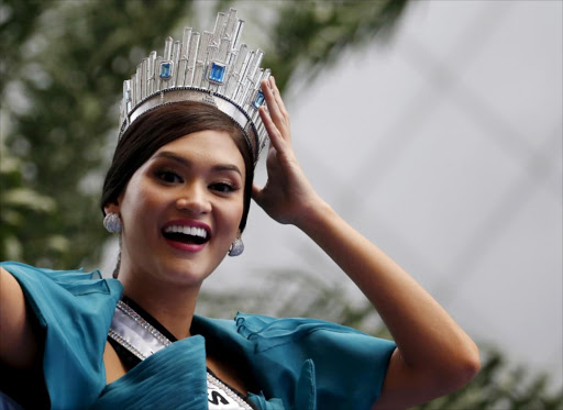 Miss Universe 2015 Pia Alonzo Wurtzbach from the Philippines holds her crown as she waves to the crowd during a motorcade at Makati financial district in Manila. REUTERS/Erik De Castro/File Photo