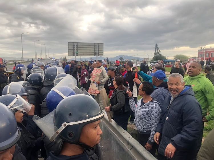 Riot police confront Bishop Lavis residents who blockaded the suburb on Wednesday September 12 in a protest against violence.